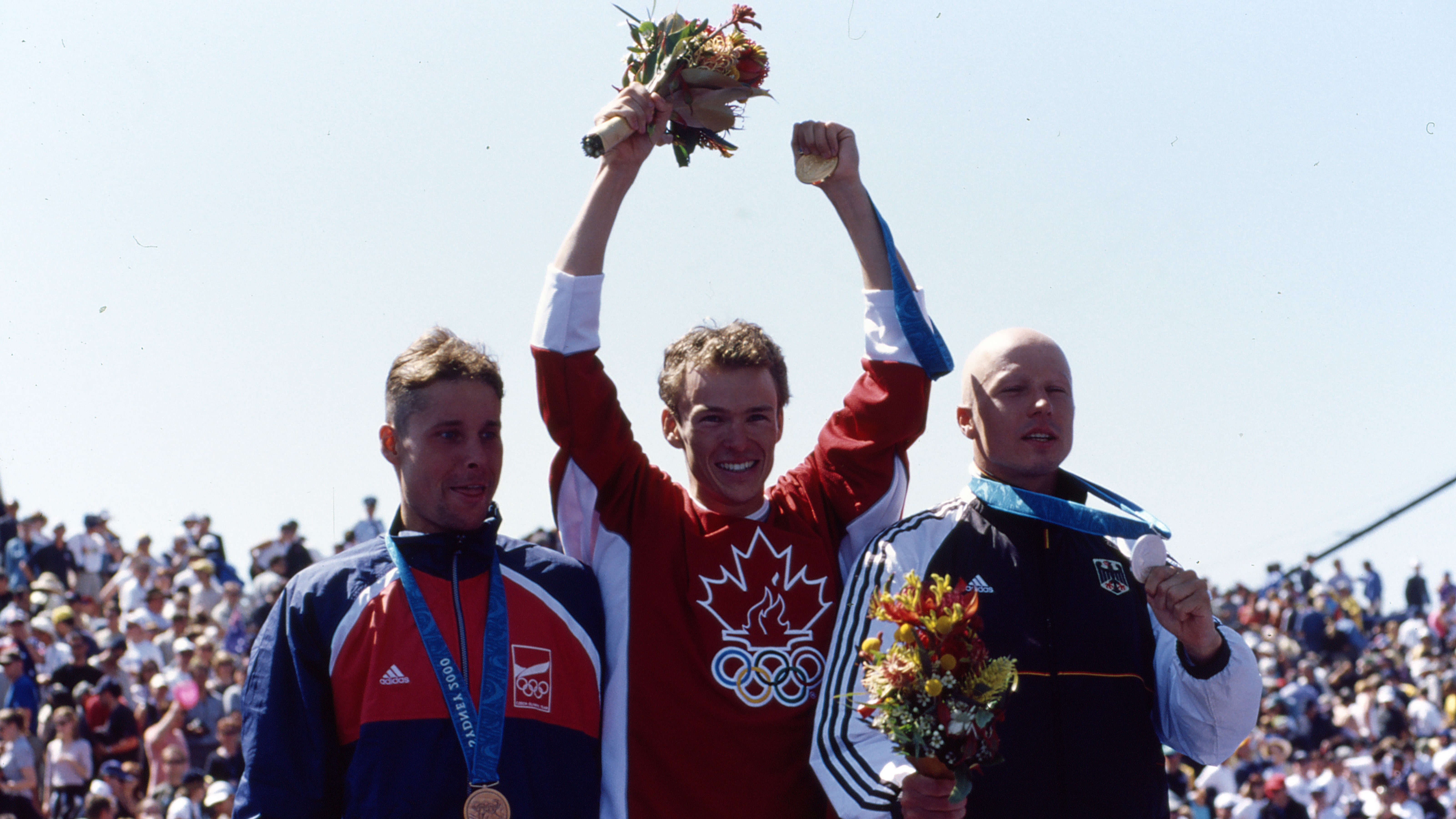 The 3 male medallists at the Sydney 2000 Olympics: Jan Rehula (CZE) - Bronze, Simon Whitfield (CAN) - Gold, Stephan Vuckovic (GER) - Silver