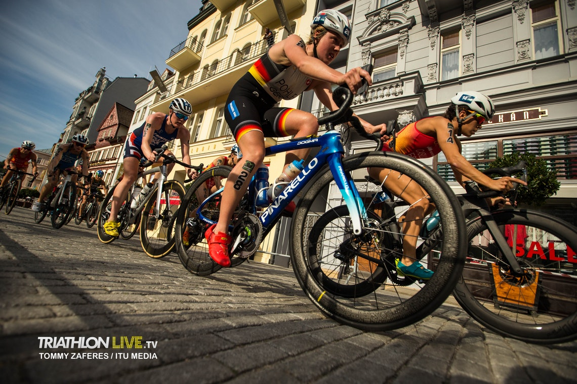 Group of triathletes cycling in a draft legal race
